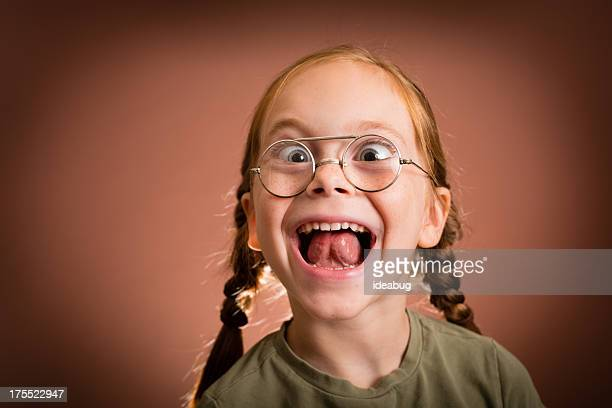 Little Girl Making Silly Face While Wearing Vintage Nerdy Glasses