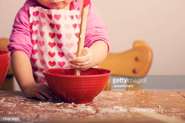 Little Girl Mixing Ingredients in Red Bowl