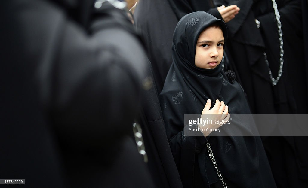 A little girl mourns as she enchains herself through the universal Ashura Day that is held at Halkali Arena Park on November 13, 2013 in Istanbul, Turkey. Ashura day is well-known because of mourning for the martyrdom of Husayn ibn Ali, the second grandson of Muhammad, who was killed during the Battle of Karbala in 680.