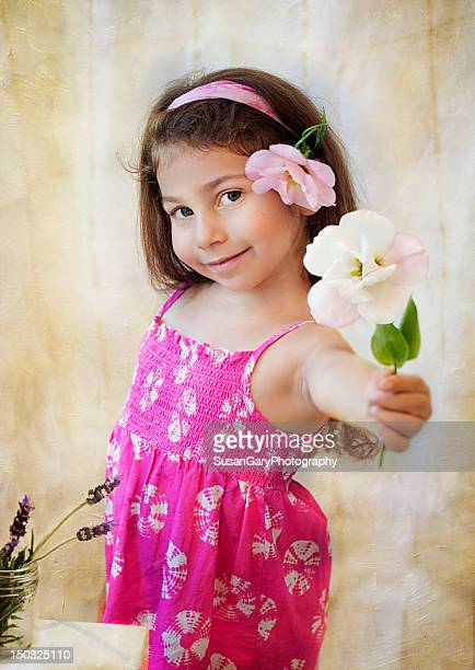 Little girl offers pink lisianthus