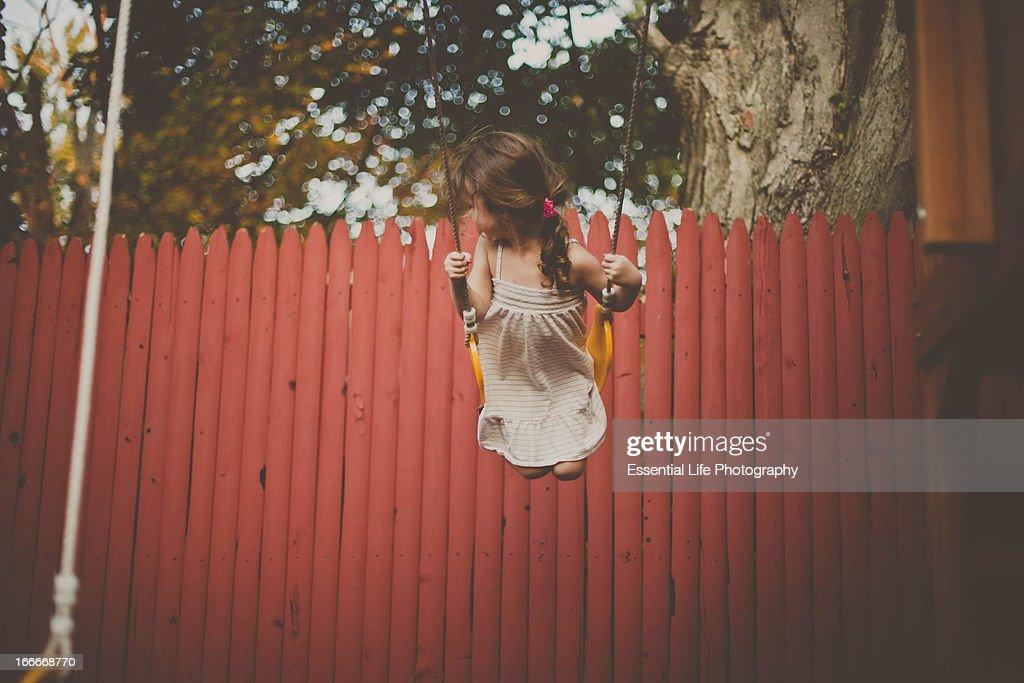 Little girl on a swing : Stock Photo
