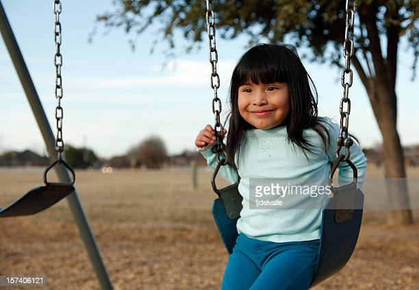 Little girl on a swingset