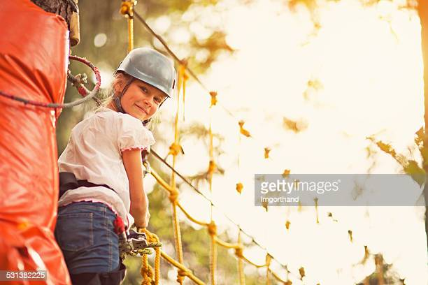 Little girl on canopy tour in adventure park