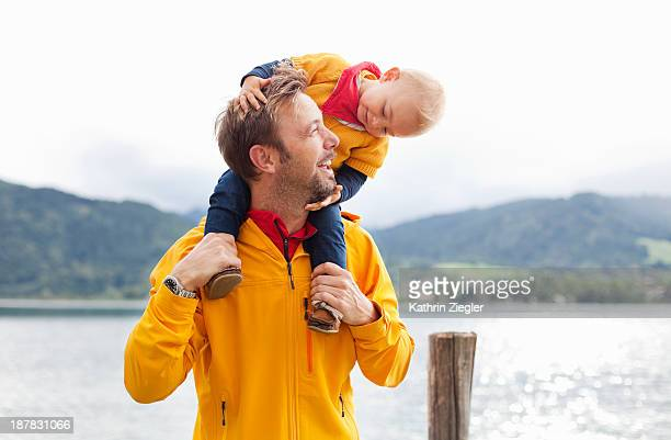 little girl on her father's shoulders