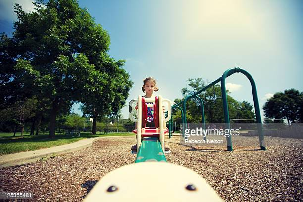 Little girl on see saw