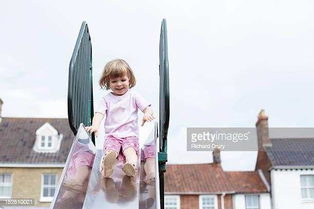 Little girl on slide in playground