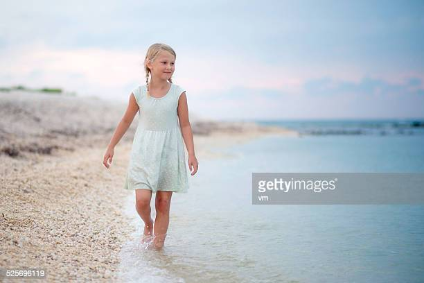 Little Girl on the Beach on Cloudy Day