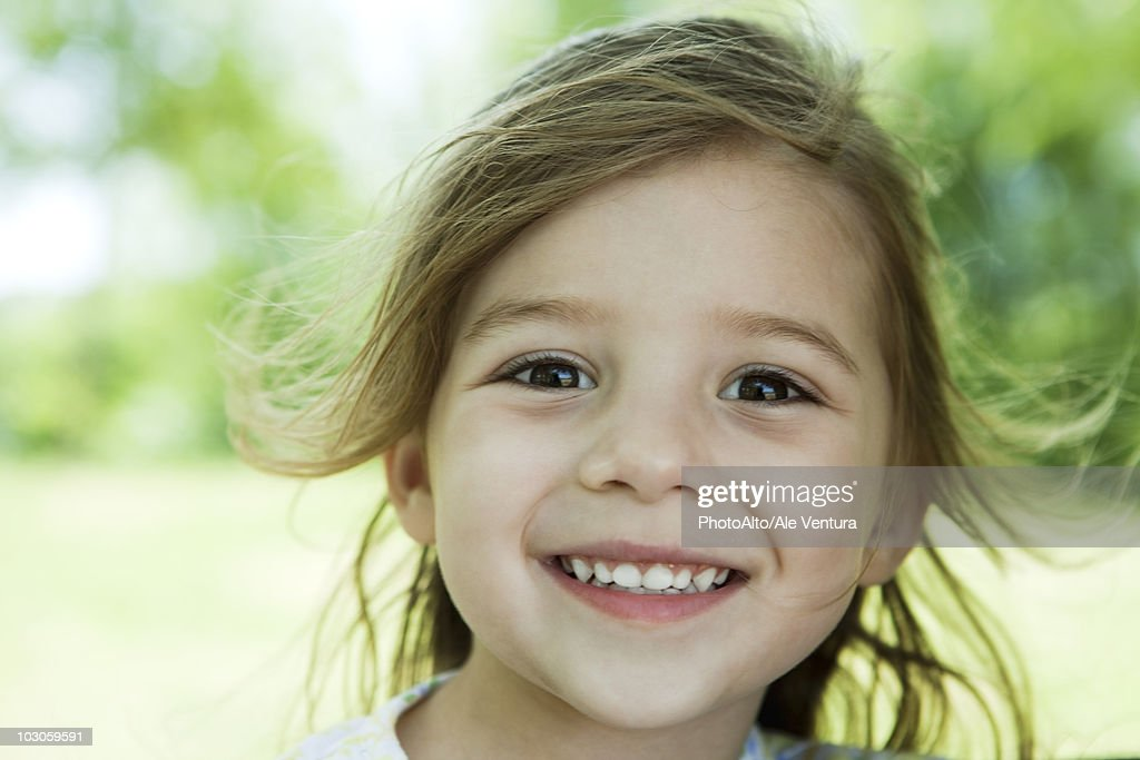 Little girl outdoors, portrait : Stock Photo