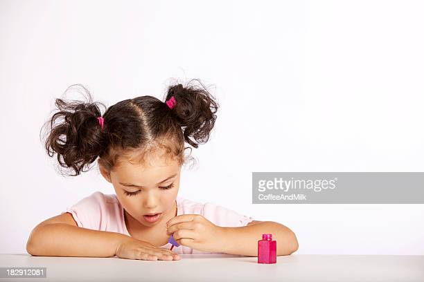 Little girl paints nails