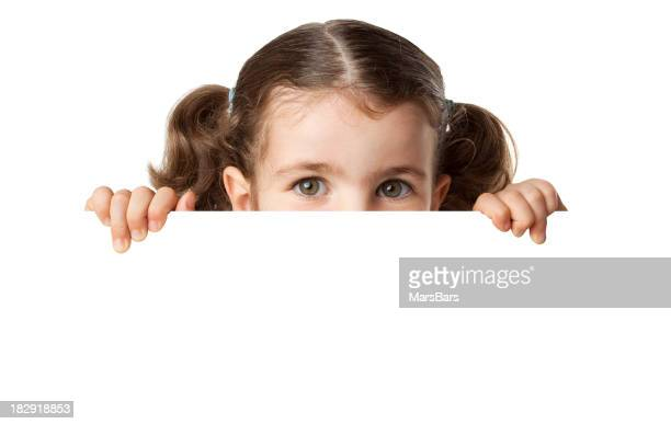 Little girl peeking from blank sign