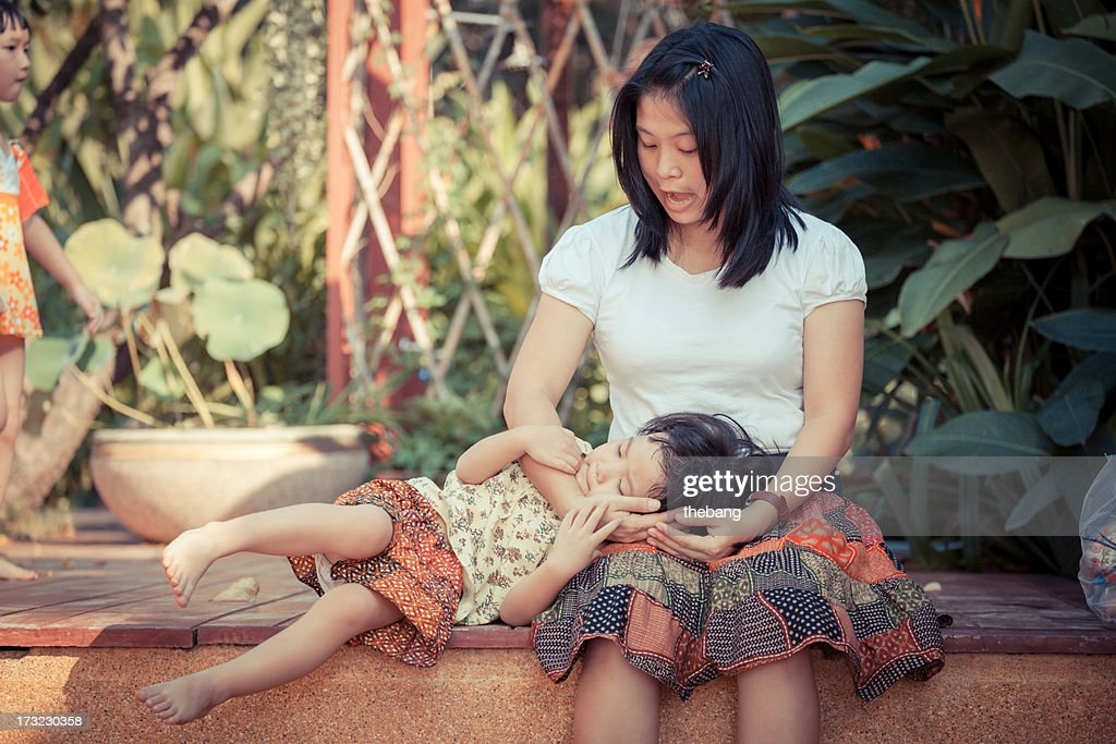 Little girl play with mom