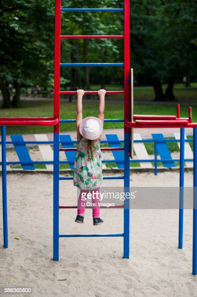 Little Girl Playing at Park Alone