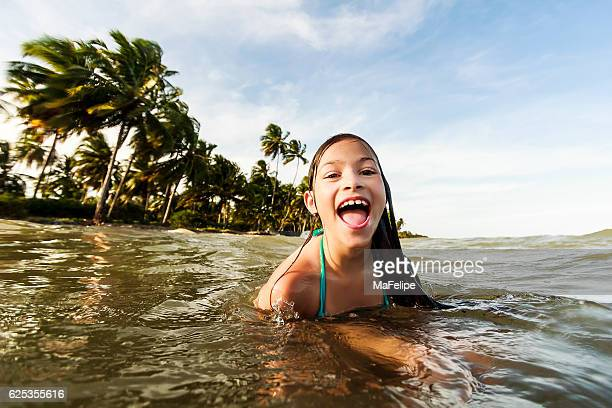 Little Girl Playing at Sea in Tropical Beach