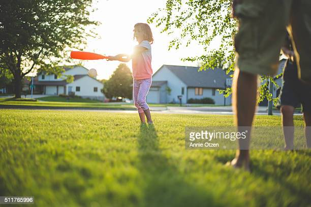 Little Girl Playing Baseball with Her Father