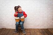 Little girl playing bongo