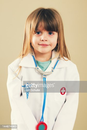 A little girl playing doctor : Stock Photo