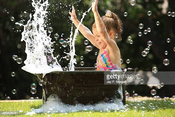 Little girl playing in bubble bath