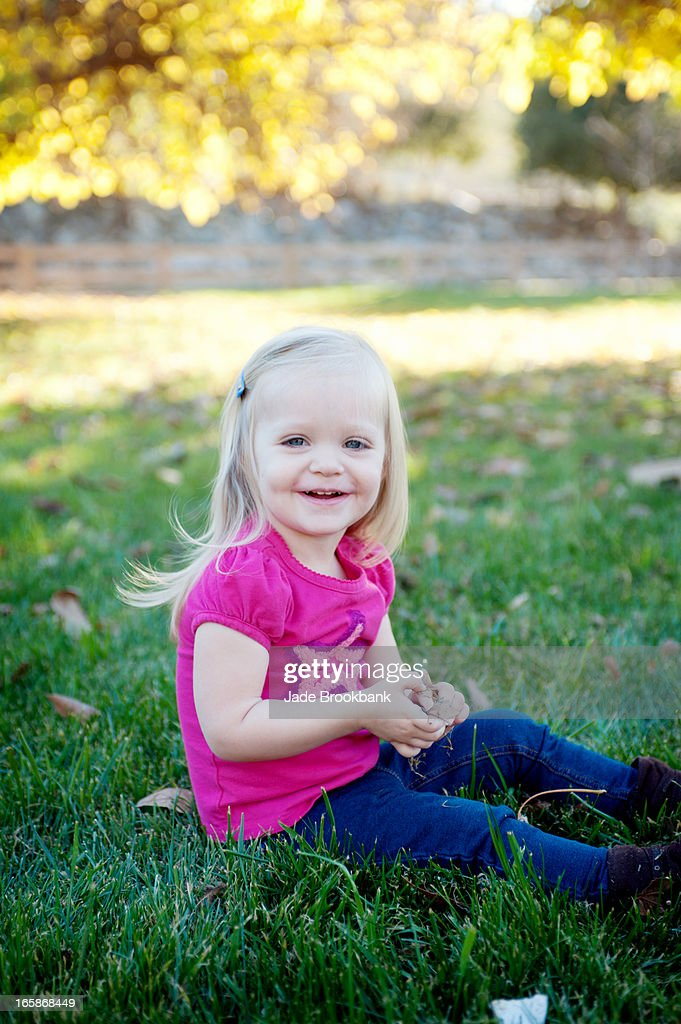 Little girl playing in park. : Stock Photo