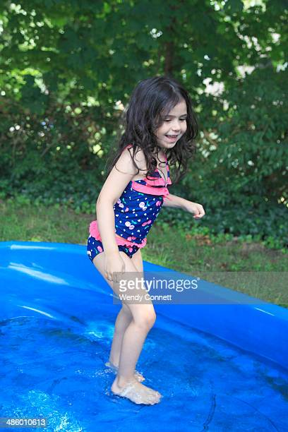 Little Girl Playing in Pool