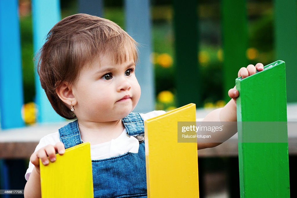 Little girl playing  in the garden : Stock Photo