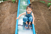 Little girl playing on the slide