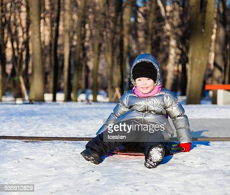 Little girl playing outdoors in winter : Stock Photo