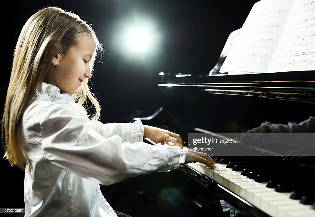 nudist little girl playing piano