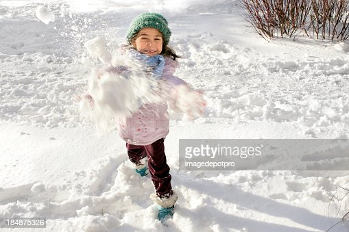 little girl playing snowball