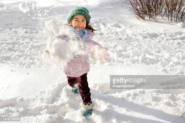 little girl playing snowball