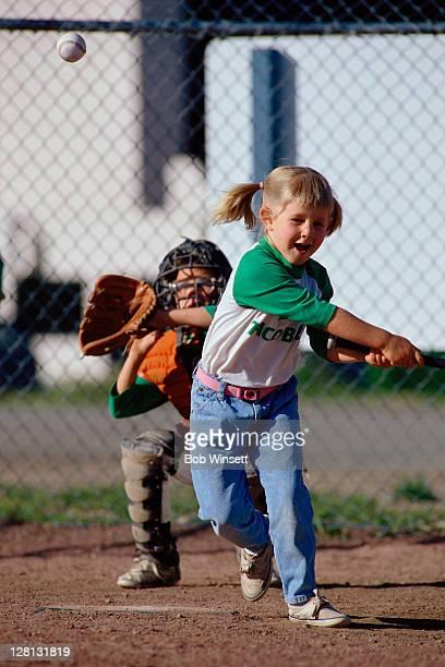 CHIPL085 Little girl playing softball