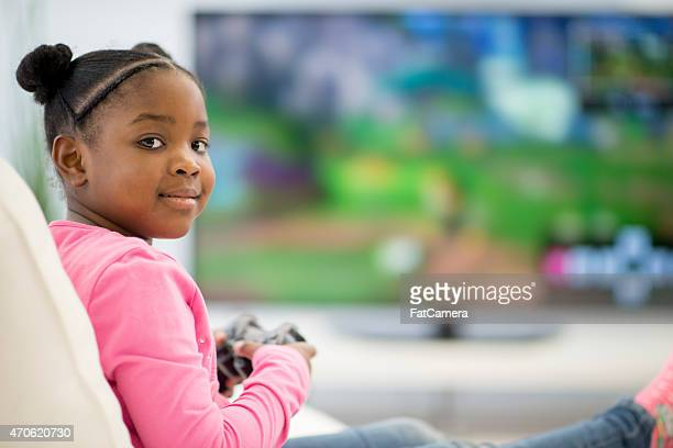Little Girl playing Video Games