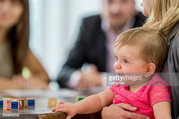 Little Girl Playing While Her Mother Works