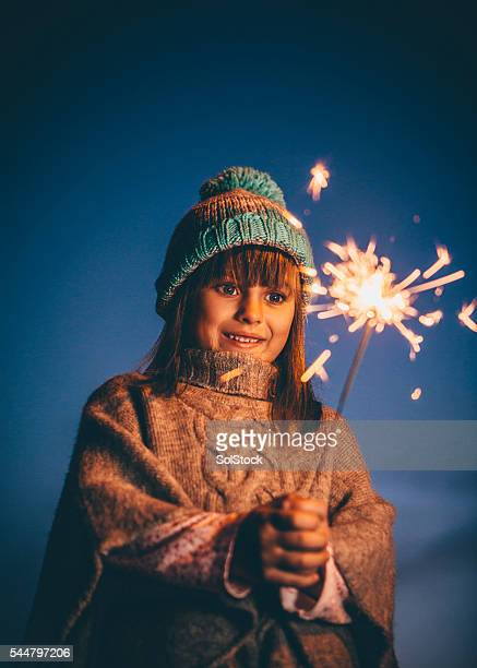 Little Girl Playing With a Sparkler