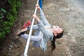 Little girl playing with an iron bar