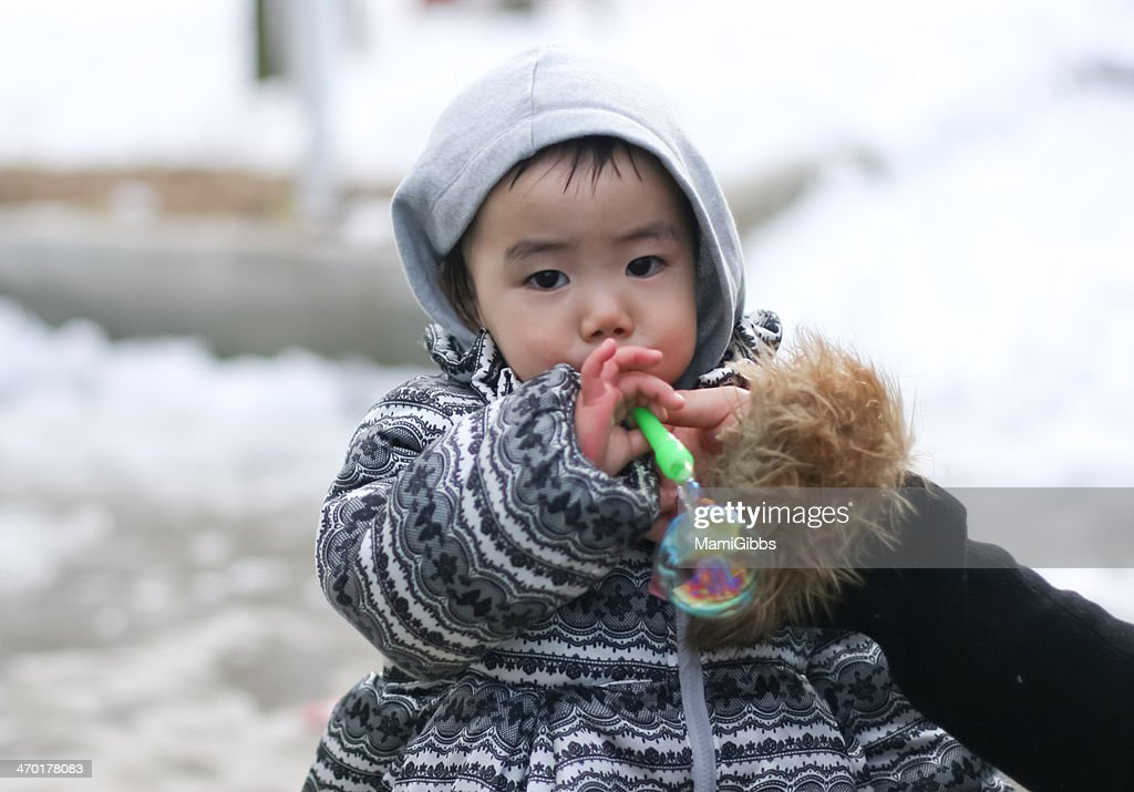 Little girl playing with bubbles : Stock Photo