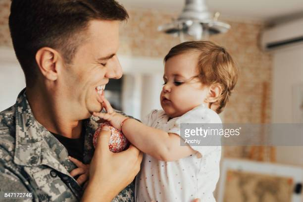 Little girl playing with her father's lips