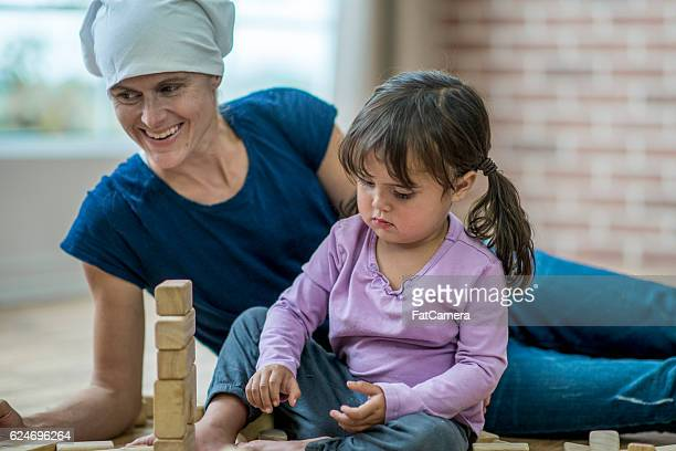 Little Girl Playing with Her Sick Mother