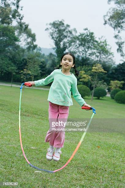 Little girl playing with jumping rope