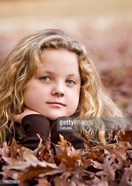 Little Girl Posing in Autumn Leaves