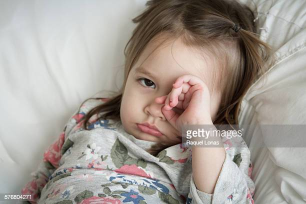 Little girl pouting or feeling ill