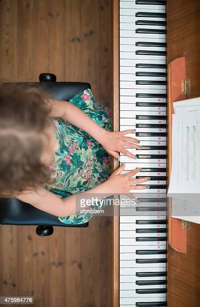 little girl practice piano