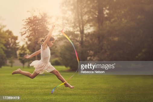 Little girl practicing ribbon gymnastics