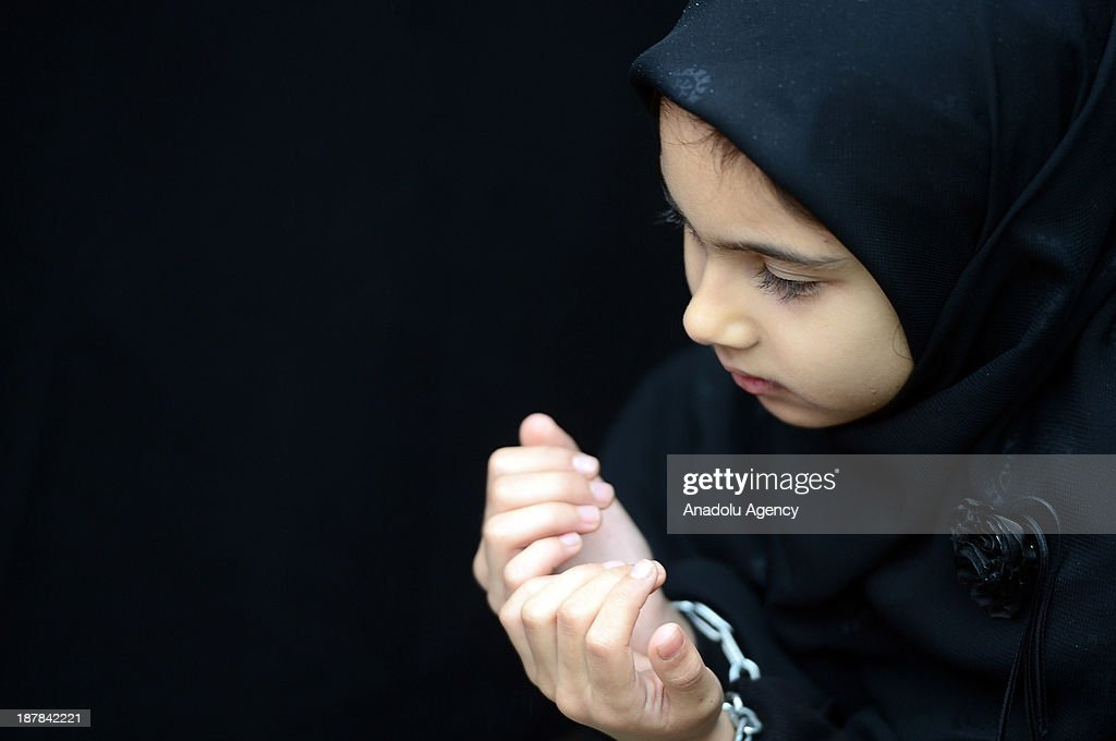 A little girl prays during the universal Ashura Day that is held at Halkali Arena Park on November 13, 2013 in Istanbul, Turkey. Ashura day is well-known because of mourning for the martyrdom of Husayn ibn Ali, the second grandson of Muhammad, who was killed during the Battle of Karbala in 680.