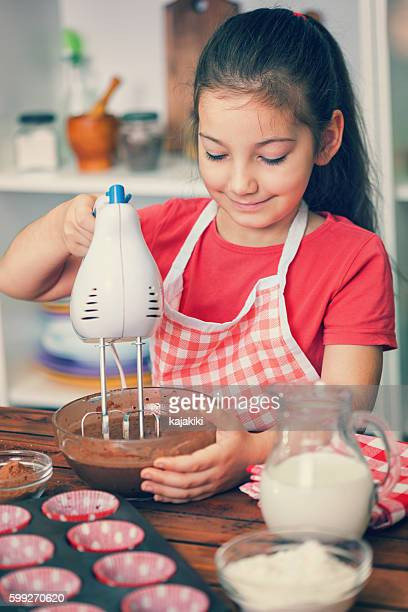 Little Girl Preparing Chocolate Cookies at Home