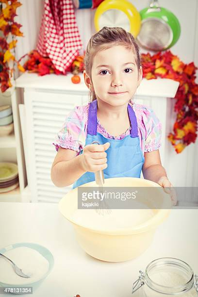 Little Girl Preparing Cookies in the Kitchen