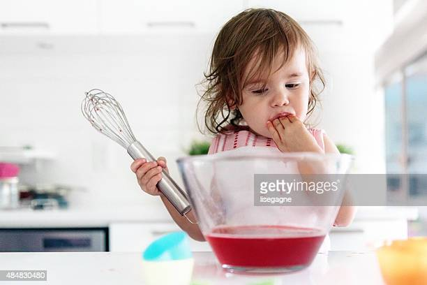 Little girl preparing jello