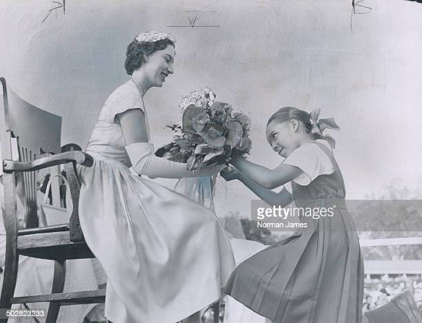 A little girl presents a bouquet at Kingstown St Vincent one of the Windward islands Gay smiling and completely at ease Margaret chatted and joked...