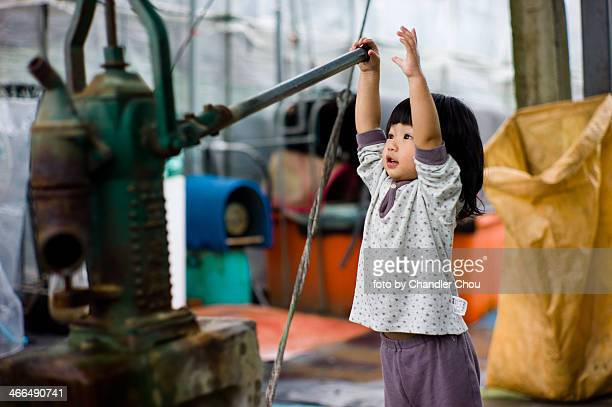 Little girl pumping pump