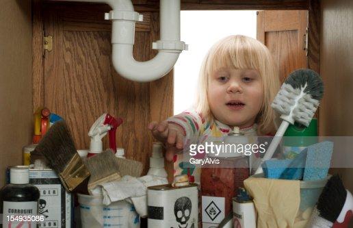 CHILD SAFETY SERIES-#2 little girl reaching under sink