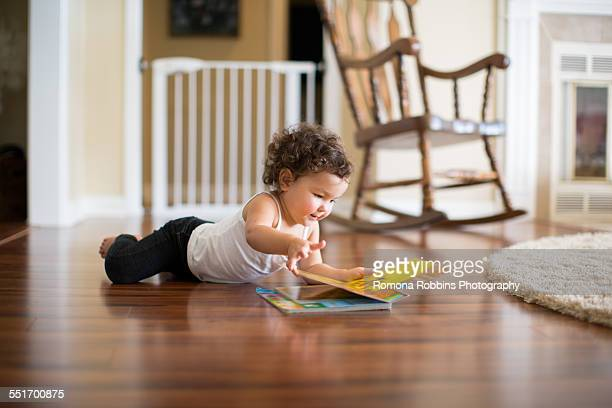 Little girl reading board book